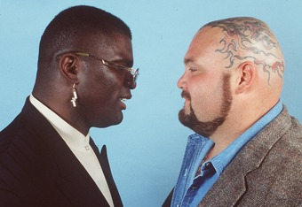 21 Mar 1995: FORMER NFL LINEBACKER LAWRENCE TAYLOR (LEFT) SQUARES OFF WITH PROFESSIONAL WRESTLER BAM BAM BIGELOW DURING A PRESS CONFERENCE AT OVATIONS IN THE CORESTATES SPECTRUM IN PHILADELPHIA, PENNSYLVANIA PRIOR TO THEIR WRESTLEMANIA XI SHOWDOWN.