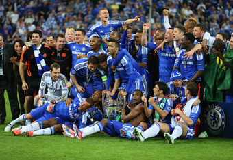 MUNICH, GERMANY - MAY 19:  Chelsea players celebrate with the trophy after their victory in the UEFA Champions League Final between FC Bayern Muenchen and Chelsea at the Fussball Arena München on May 19, 2012 in Munich, Germany.  (Photo by Alex Livesey/Ge