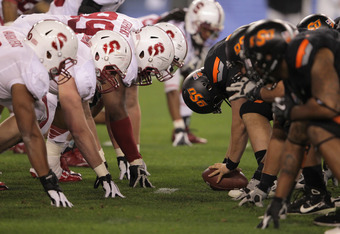 GLENDALE, AZ - JANUARY 02:  The Stanford Cardinal defense lines up on the line of scrimmage against the Oklahoma State Cowboys during the Tostitos Fiesta Bowl on January 2, 2012 at University of Phoenix Stadium in Glendale, Arizona.  (Photo by Doug Pensin