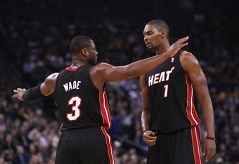 OAKLAND, CA - JANUARY 10:  Dwyane Wade #3 of the Miami Heat talks to Chris Bosh #1 of the Miami Heat during their game against the Golden State Warriors at Oracle Arena on January 10, 2012 in Oakland, California.  NOTE TO USER: User expressly acknowledges