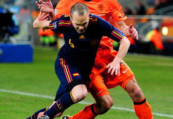 JOHANNESBURG, SOUTH AFRICA - JULY 11:  Andres Iniesta of Spain is tackled by Robin Van Persie of the Netherlands during the 2010 FIFA World Cup South Africa Final match between Netherlands and Spain at Soccer City Stadium on July 11, 2010 in Johannesburg,