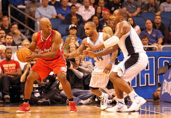 ORLANDO, FL - FEBRUARY 06:  Chauncey Billups #1 of the Los Angeles Clippers is guarded by Glen Davis #11 and Jameer Nelson #14 of the Orlando Magic during the game at Amway Center on February 6, 2012 in Orlando, Florida.   NOTE TO USER: User expressly ack