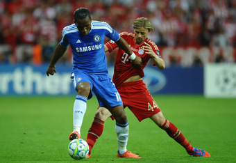 MUNICH, GERMANY - MAY 19:  Didier Drogba of Chelsea is challenged by Anatoliy Tymoshchuk of FC Bayern Muenchen during UEFA Champions League Final between FC Bayern Muenchen and Chelsea at the Fussball Arena München on May 19, 2012 in Munich, Germany.  (Ph