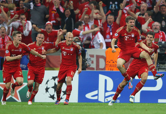MUNICH, GERMANY - MAY 19:  Thomas Mueller (C) of Bayern Muenchen is congratulated team mates after scoring the opening goal during UEFA Champions League Final between FC Bayern Muenchen and Chelsea at the Fussball Arena München on May 19, 2012 in Munich,
