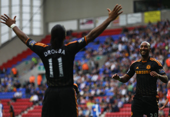 WIGAN, ENGLAND - AUGUST 21:  Nicolas Anelka of Chelsea celebrates with Didier Drogba (11) as he scores their third goal during the Barclays Premier League match between Wigan Athletic and Chelsea at DW Stadium on August 21, 2010 in Wigan, England.  (Photo