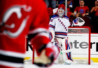 NEWARK, NJ - MAY 21:  Henrik Lundqvist #30 of the New York Rangers stands in goal in Game Four of the Eastern Conference Final against the New Jersey Devils during the 2012 NHL Stanley Cup Playoffs at the Prudential Center on May 21, 2012 in Newark, New J
