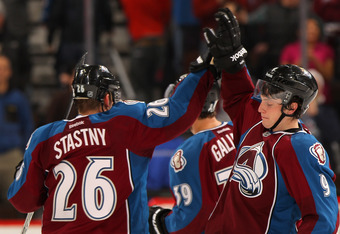 DENVER, CO - DECEMBER 23:  Paul Stastny #26 and Matt Duchene #9 of the Colorado Avalanche celebrate after Duchene's game winning overtime goal against the Tampa Bay Lightning at the Pepsi Center on December 23, 2011 in Denver, Colorado. The Avalanche defe