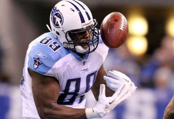 INDIANAPOLIS, IN - DECEMBER 18:  Jared Cook #89 of the Tennessee Titans fumbles the ball during the NFL game against the Indianapolis Colts at Lucas Oil Stadium on December 18, 2011 in Indianapolis, Indiana.  (Photo by Andy Lyons/Getty Images)
