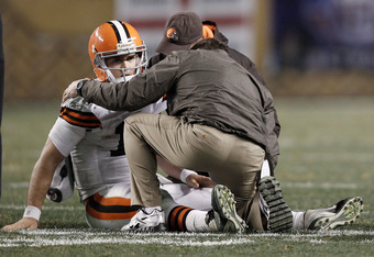 PITTSBURGH, PA - DECEMBER 08:  Colt McCoy #12 of the Cleveland Browns lays on the ground while speaking to athletic trainers after a helmet to helmet hit from James Harrison #92 of the Pittsburgh Steelers during the game on December 8, 2011 at Heinz Field