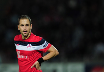 LILLE, FRANCE - OCTOBER 18:  Joe Cole of LOSC Lille Metropole in action during the UEFA Champions League, group B match between LOSC Lille Metropole and FC Internazionale Milano  at Stade Lille-Metropole on October 18, 2011 in Lille, France.  (Photo by Ja