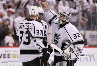 GLENDALE, AZ - MAY 22:  Willie Mitchell #33, Anze Kopitar #11 and goaltender Jonathan Quick #32 of the Los Angeles Kings celebrate the Kings 4-3 overtime victory against the Phoenix Coyotes in Game Five of the Western Conference Final during the 2012 NHL