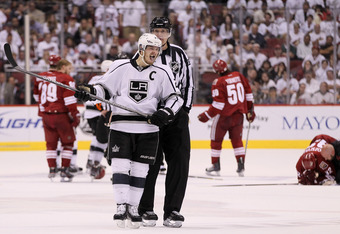 As Michal Rozsival lay on the ice to the right, the Coyotes were livid Dustin Brown received no penalty.