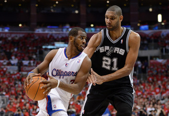 LOS ANGELES, CA - MAY 20:  Chris Paul #3 of the Los Angeles Clippers drives on Tim Duncan #21 of the San Antonio Spurs in the third quarter in Game Four of the Western Conference Semifinals in the 2012 NBA Playoffs on May 20, 2011 at Staples Center in Los