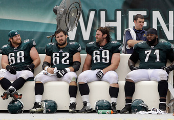 PHILADELPHIA, PA - SEPTEMBER 25: Offensive players  Kyle DeVan #68, Jason Kelce #62, Evan Mathis #69, and Jason Peters #71 of the Philadelphia Eagles sit on the bench during the fourth quarter against the New York Giants at Lincoln Financial Field on Sept