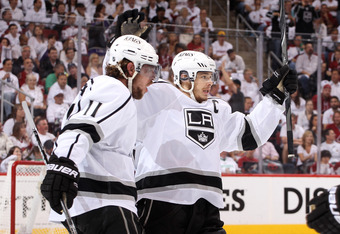 GLENDALE, AZ - MAY 22:  Anze Kopitar #11 of the Los Angeles Kings celebrates with teammate Dustin Brown #23 after Kopitar tips in a shorthanded goal in the first period on a shot by teammate Drew Doughty #8 past goaltender Mike Smith #41 of the Phoenix Co