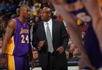 DENVER, CO - FEBRUARY 03:  Head coach Mike Brown talks with Kobe Bryant #24 of the Los Angeles Lakers during a break in the action against the Denver Nuggets at the Pepsi Center on February 3, 2012 in Denver, Colorado. NOTE TO USER: User expressly acknowl