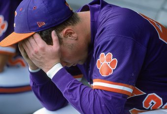 14 Jun 2000: Ryan Riley #42 of the Clemson Tigers hangs his head as he sits in the dugout during the College World Series againt the Louisiana Lafayette Ragin Cajuns at the Resenblatt Stadium in Omaha, Nebraska. The Raggin Cajuns defeated the Tigers 6-3.M