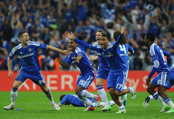 MUNICH, GERMANY - MAY 19:  (L-R) Gary Cahill, Florent Malouda, Fernando Torres and Jose Bosingwa of Chelsea celebrate after Didier Drogba scored the winning penalty during UEFA Champions League Final between FC Bayern Muenchen and Chelsea at the Fussball