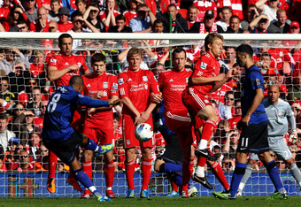 LIVERPOOL, ENGLAND - OCTOBER 15:  Ashley Young of Manchester United takes a free kick during the Barclays Premier League match between Liverpool and Manchester United at Anfield on October 15, 2011 in Liverpool, England. (Photo by Clive Brunskill/Getty Im