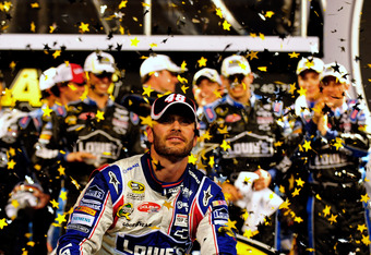 CHARLOTTE, NC - MAY 19:  Jimmie Johnson, driver of the #48 Lowe's Patriotic Chevrolet, celebrates in victory lane after winning the NASCAR Sprint All-Star Race at Charlotte Motor Speedway on May 19, 2012 in Charlotte, North Carolina.  (Photo by Jamey Pric