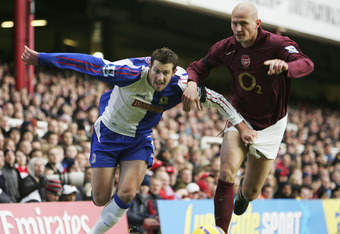 LONDON - NOVEMBER 26:  Brett Emerton of Blackburn Rovers gets to grips with Pascal Cygan of Arsenal during the FA Barclays Premiership match between Arsenal and Blackburn Rovers at Highbury on November 26, 2005 in London, England.  (Photo by Clive Mason/G