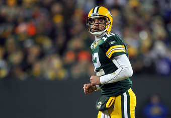 GREEN BAY, WI - JANUARY 15:  Aaron Rodgers #12 of the Green Bay Packers looks on in the third quarter against the New York Giants during their NFC Divisional playoff game at Lambeau Field on January 15, 2012 in Green Bay, Wisconsin.  (Photo by Jamie Squir