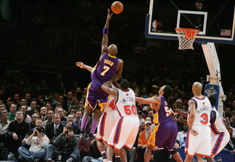 NEW YORK - FEBRUARY 28:  Lamar Odom #7 of the Los Angeles Lakers shoots against the New York Knicks during the game on February 28, 2005 at Madison Square Garden in New York City.  The Knicks won 117-115.  NOTE TO USER:  User expressly acknowledges and ag