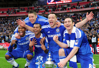LONDON, ENGLAND - MAY 05: Daniel Sturridge, Gary Cahill, Ashley Cole, John Terry and Frank Lampard celebrate with the trophy during the FA Cup with Budweiser Final match between Liverpool and Chelsea at Wembley Stadium on May 5, 2012 in London, England.