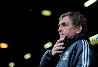 NORWICH, ENGLAND - APRIL 28:  Kenny Dalglish the Liverpool manager looks on during the Barclays Premier League match between Norwich City and Liverpool at Carrow Road on April 28, 2012 in Norwich, England.  (Photo by Jamie McDonald/Getty Images)