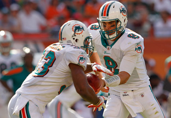 MIAMI GARDENS, FL - JANUARY 01:   Matt Moore #8 hands off to  Steve Slaton #23 of the Miami Dolphins during a game  at Sun Life Stadium on January 1, 2012 in Miami Gardens, Florida.  (Photo by Mike Ehrmann/Getty Images)