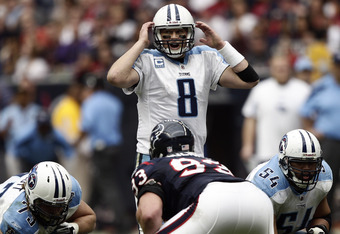 HOUSTON, TX - JANUARY 01:  Quarterback Matt Hasselbeck #8 of the Tennessee Titans calls out a play at the line of scrimmage against the Houston Texans at Reliant Stadium on January 1, 2012 in Houston, Texas.  (Photo by Bob Levey/Getty Images)