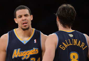 LOS ANGELES, CA - MAY 12:  JaVale McGee #34 and Danilo Gallinari #8 of the Denver Nuggets react in the second quarter while taking on the Los Angeles Lakers in Game Seven of the Western Conference Quarterfinals in the 2012 NBA Playoffs on May 12, 2012 at