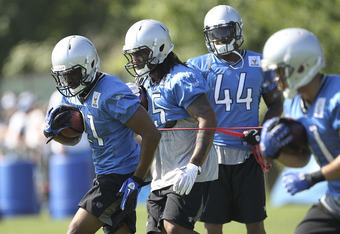 ALLEN PARK, MI - JULY 30: Aaron Brown #21 and Mikel Leshoure #25 go through the morning drills druing the Lions training camp on July 30, 2011 in Allen Park, Michigan.  (Photo by Leon Halip/Getty Images)