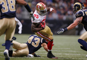 ST. LOUIS, MO - JANUARY 1:  Tight end Vernon Davis #85 of the San Francisco 49ers runs the ball against the St. Louis Rams in the second half of the game on January 1, 2012 at the Edward Jones Dome in St. Louis, Missouri. The 49ers defeated the Rams 34-27