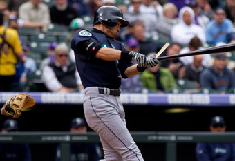 DENVER, CO - MAY 19:  Ichiro Suzuki #51 of the Seattle Mariners breaks his bat on his way to an infield single against the Colorado Rockies at Coors Field on May 19, 2012 in Denver, Colorado.  The Mariners defeated the Rockies 10-3.  (Photo by Justin Edmo