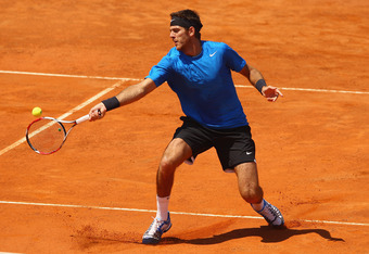 ROME, ITALY - MAY 15:  Juan Martin Del Potro of Argentina plays a forehand volley against  Michael Llodra of France   in their second round match during day four of the Internazionali BNL d'Italia 2012 at the Foro Italico Tennis Centre  on May 15, 2012 in