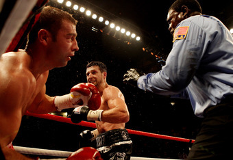 NOTTINGHAM, ENGLAND - MAY 26:  Carl Froch knockls out Lucian Bute during their IBF World Super Middleweight Title bout at Nottingham Capital FM Arena on May 26, 2012 in Nottingham, England.  (Photo by Scott Heavey/Getty Images)