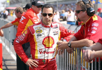 INDIANAPOLIS, IN - MAY 19:  Helio Castroneves the driver of the Shell V-Power/Pennzoil Ultra Team Penske car prepares for his qualifying run for the Indianapolis 500 at Indianapolis Motor Speedway on May 19, 2012 in Indianapolis, Indiana.  (Photo by Andy