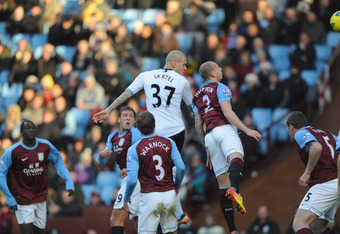 BIRMINGHAM, ENGLAND - DECEMBER 18: Martin Skrtel of Liverpool scores to make it 2-0 during the Barclays Premier league match between Aston Villa and Liverpool at Villa Park on December 18, 2011 in Birmingham, England.  (Photo by Michael Regan/Getty Images