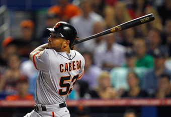 Melky Cabrera has helped Matt Cain learn how it feels to pitch with a lead.