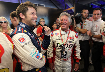 INDIANAPOLIS, IN - MAY 27:  (L-R) Marco Andretti, driver of the #26 Team RC Cola Chevrolet shares a laugh with his grandfather Mario Andretti prior to the start of the IZOD IndyCar Series 96th running of the Indianapolis 500 mile race at the Indianapolis