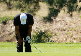 PONTE VEDRA BEACH, FL - MAY 11: Tiger Woods of the United States reacts to his putt on the seventh hole during the second round of THE PLAYERS Championship held at THE PLAYERS Stadium course at TPC Sawgrass on May 11, 2012 in Ponte Vedra Beach, Florida.