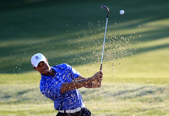 PONTE VEDRA BEACH, FL - MAY 09:  Tiger Woods of the United States hits a shot from a bunker during a practice round prior to the start of THE PLAYERS Championship held at THE PLAYERS Stadium course at TPC Sawgrass on May 9, 2012 in Ponte Vedra Beach, Flor