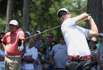 FORT WORTH, TX - MAY 27: Zach Johnson (R) watches his tee