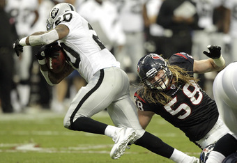 HOUSTON - OCTOBER 09: Running back Darren McFadden #20 of the Oakland Raiders eludes a tackle by Brooks Reed #58 of the Houston Texans at Reliant Stadium on October 9, 2011 in Houston, Texas. (Photo by Bob Levey/Getty Images)