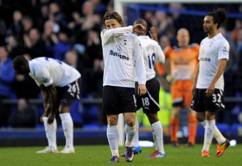 LIVERPOOL, ENGLAND - MARCH 10:   Luka Modric of Tottenham Hotspur and his team mates show their dejection after conceding the opening goal during the Barclays Premier League match between Everton and Tottenham Hotspur at Goodison Park on March 10, 2012 in