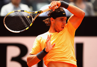 ROME, ITALY - MAY 21:  Rafael Nadal of Spain in action against Novak Djokovic of Serbia in their final match during day ten of the Internazionali BNL d'Italia 2012 at the Foro Italico Tennis Centre on May 21, 2012 in Rome, Italy.  (Photo by Clive Brunskil