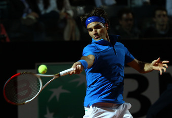 ROME, ITALY - MAY 19:  Roger Federer of Switzerland plays a forehand against Novak Djokovic of Serbia in their semi final match during day eight of the Internazionali BNL d'Italia 2012 at the Foro Italico Tennis Centre on May 19, 2012 in Rome, Italy.  (Ph