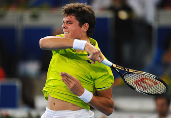 MADRID, SPAIN - MAY 09:  Milos Raonic of Canada in action during his 3rd round defeat to Roger Federer of Switzerland in the Mutua Madrilena Madrid Open at the Caja Magica on May 9, 2012 in Madrid, Spain.  (Photo by Mike Hewitt/Getty Images)