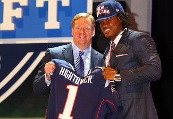 NEW YORK, NY - APRIL 26:  Dont'a Hightower of Alabama holds up a jersey as he stands on stage with NFL Commissioner Roger Goodell after he was selected #25 overall by the New England Patriots in the first round of the 2012 NFL Draft at Radio City Music Ha